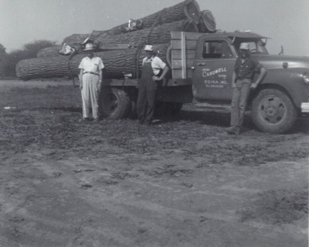 Leroy Cardwell in front of Lumber Truck